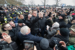 "© Licensed to London News Pictures . 18/03/2018 . London , UK . TOMMY ROBINSON (centre) takes a selfie with the crowd . 1000s including supports of alt-right groups such as Generation Identity and the Football Lads Alliance , at Speakers' Corner in Hyde Park where Tommy Robinson reads a speech by Generation Identity campaigner Martin Sellner . Along with Brittany Pettibone , Sellner was due to deliver the speech last week but the pair were arrested and detained by police when they arrived in the UK , forcing them to cancel an appearance at a UKIP "" Young Independence "" youth event , which in turn was reportedly cancelled amid security concerns . Photo credit: Joel Goodman/LNP"