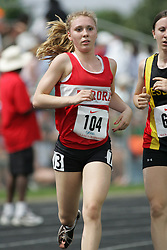 Hamilton, Ontario ---07/06/08--- Ania Batko of Aurora in Aurora competes in the 3000 meters at the 2008 OFSAA Track and Field meet in Hamilton, Ontario..Sean Burges