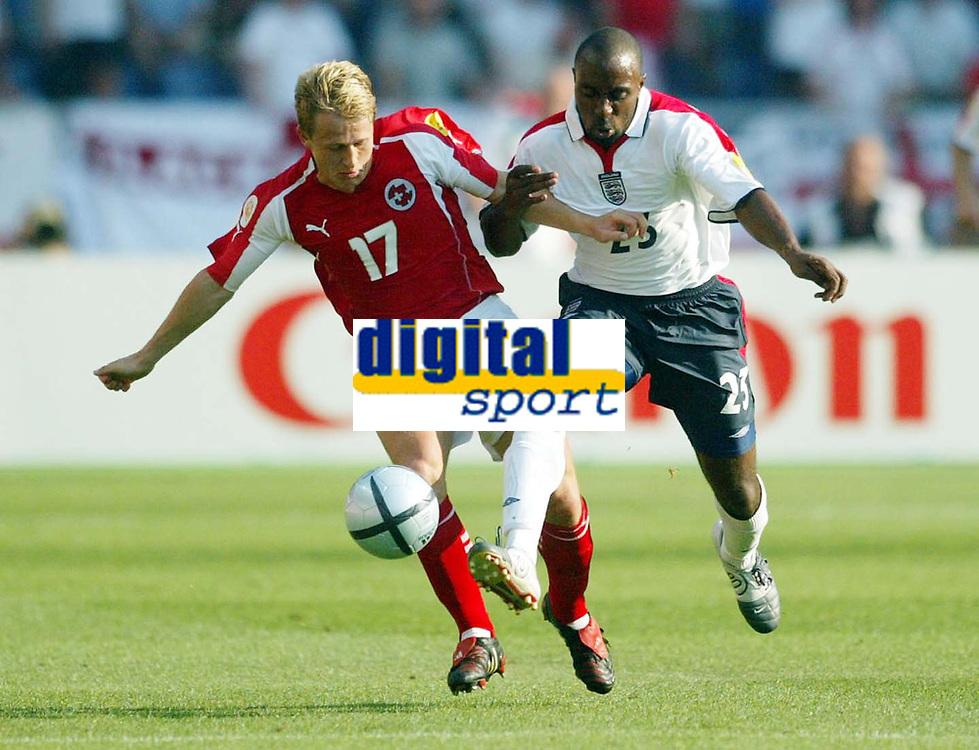 Photo: Scott Heavey, Digitalsport<br /> England v Switzerland. Group B, UEFA European Championship 2004. 17/06/2004.<br /> Darius Vassell (R) tangles with Christoph Spycher