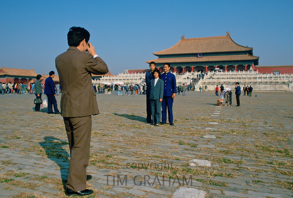 Tourists taking photographings in Forbidden City, Beijing, China