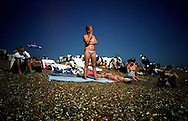 One sunny afternoon in August 2005 on Brighton beach. Kids playing around, swimming, parents sunbathing. The ideal British summer day