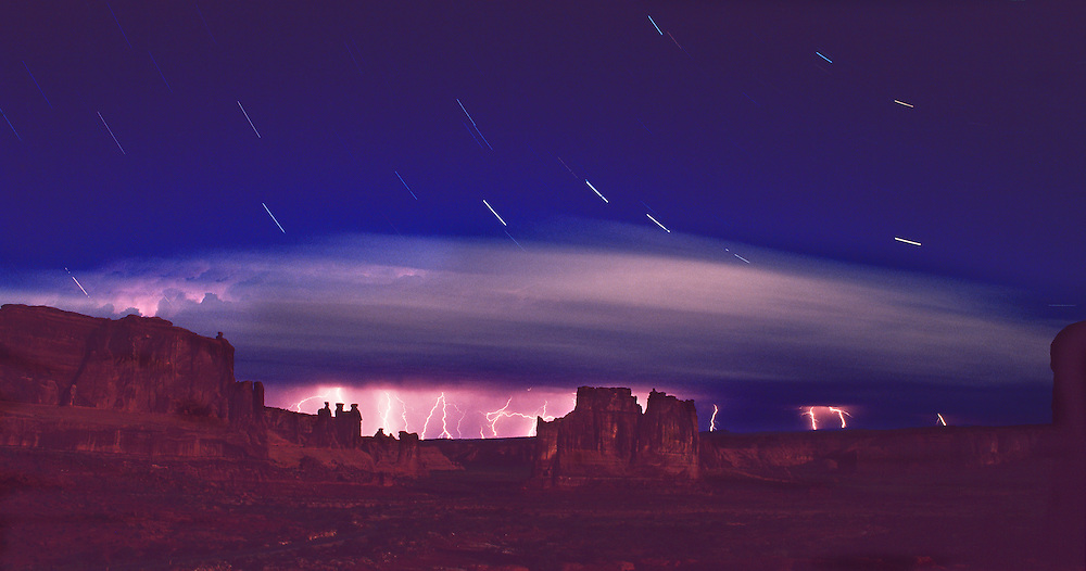 Lightning storm, star trails, moonlight, Courthouse Towers, Arches National Park