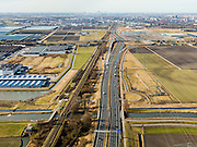 Nederland, Zuid-Holland, Zoetermeer, 20-02-2012; autosnelweg A12 gezien naar stadshart Zoetermeer, Den Haag aan de horizon.Motorway A12 seen in direction the Hague (skyline). .copyright foto/photo Siebe Swart