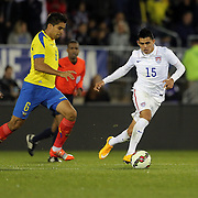 Joe Corona Crespin, (right), USA, challenged by Christian Noboa, Ecuador, in action during the USA Vs Ecuador International match at Rentschler Field, Hartford, Connecticut. USA. 10th October 2014. Photo Tim Clayton