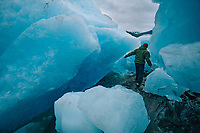 Kayak guide Corey Denton explores and ice field near Mendenhall Glacier, Juneau, AK.