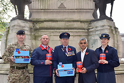 © Licensed to London News Pictures. 31/10/2017. London, UK.  (L to R) Mark Quickfall (Household Recovery Mounted Regiment), Andy Kent (TFL), Eric Reeve (TFL), Mayor of London, Sadiq Khan and Sophia Hickinson (RAF) at the War Memorial outside Euston Station in support of the Royal British Legion's London Poppy Day campaign.  The annual London Poppy Day Appeal sees 2,500 service personnel, veterans and volunteers trying to raise GBP1m in a single day.  Photo credit: Stephen Chung/LNP