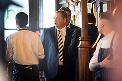 **Pictures taken from outside the pub** © London News Pictures. 07/06/2016. London, UK. Founder and Deputy Executive Chairman of Sports Direct, MIKE ASHLEY, in the Red Lion Pub on Whitehall, before he arrives at Portcullis House in London with his wife LINDA ASHLEY to give evidence to a Business, Innovation and Skills Committee about treatment of low-paid staff.. Photo credit: Ben Cawthra/LNP