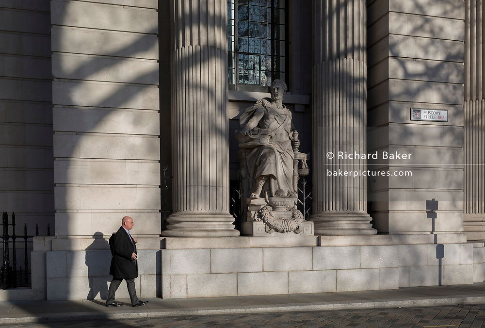 Classical architecture outside the Four Seasons hotel on the corner of Muscovy Street and Trinity Square in the City of London - the capital's financial district, on 22nd January 2019, in London England.