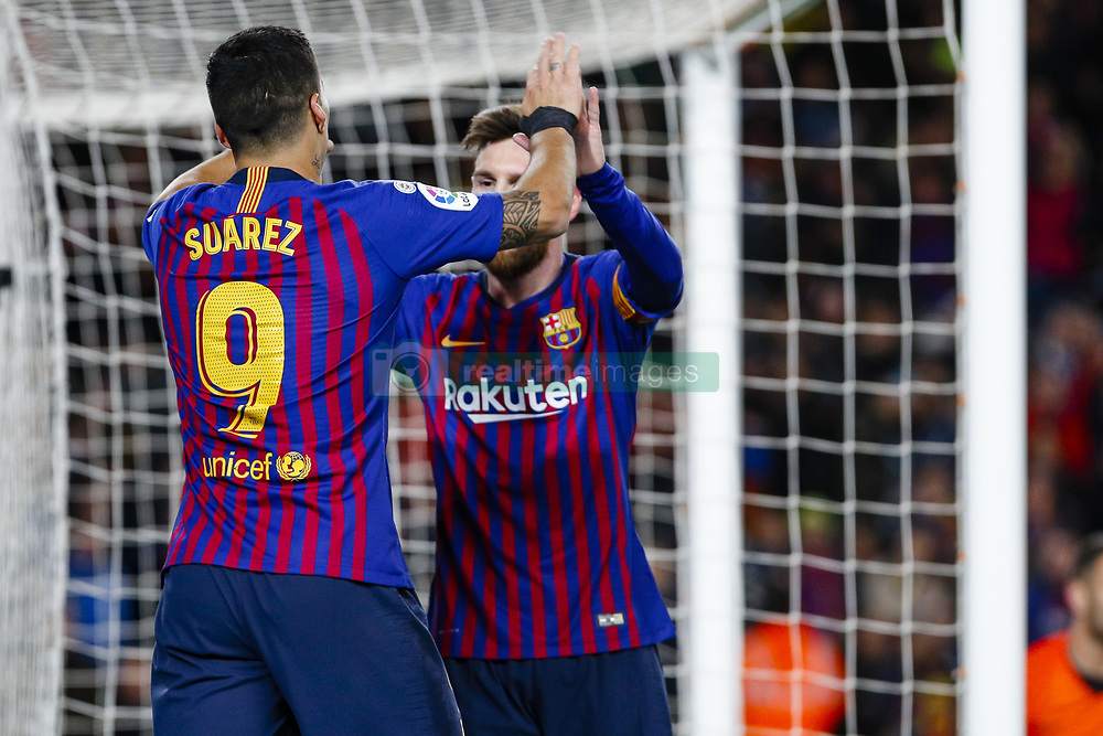 January 30, 2019 - Barcelona, Spain - FC Barcelona forward Luis Suarez (9) celebrates scoring the goal with FC Barcelona forward Lionel Messi (10) during the match FC Barcelona v Sevilla CF, for the round of 8, second leg of the Copa del Rey played at Camp Nou  on 30th January 2019 in Barcelona, Spain. (Credit Image: © Mikel Trigueros/NurPhoto via ZUMA Press)