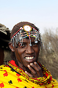 Kenya, Masai Mara, Masai (Also Maasai) Tribesmen an ethnic group of semi-nomadic people. Warriors with traditional headdress