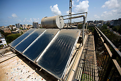 INDIA MUMBAI 29MAY10 - Solar thermal and wind generator installation on the roof of an apartment block in Juhu, Mumbai, India...jre/Photo by Jiri Rezac..© Jiri Rezac 2010