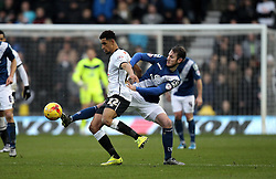 Nick Blackman of Derby County is tackled by Paul Caddis of Birmingham City - Mandatory byline: Robbie Stephenson/JMP - 16/01/2016 - FOOTBALL - iPro Stadium - Derby, England - Derby County v Birmingham City - Sky Bet Championship