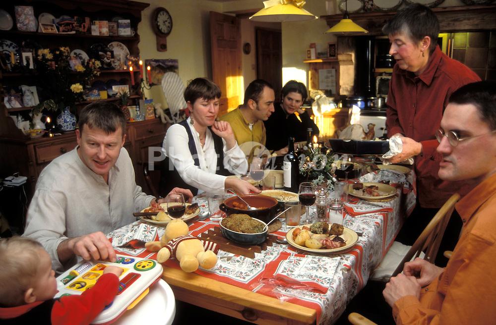 Family Christmas dinner - eating roast turkey & all the trimmings; UK