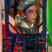 The refection of a Chinese opera singer in a mirror back stage. Butterworth, Penang, Malaysia