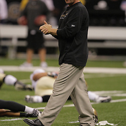 2008 August 16: New Orleans Saints Head Coach Sean Payton walks the field as the team stretches prior to a preseason match up against the Houston Texans at the Louisiana Superdome in New Orleans, LA. .