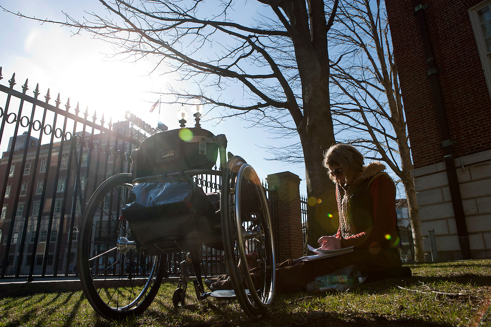 First year graduate student in urban planning Tilly Hatcher, 35, studies in the sun near Harvard Square on Wednesday, March 30, 2011 in Harvard Yard.  Hatcher, 35, has been paralyzed since age 13 due to a spinal cord tumor and subsequent surgery. Brooks Canaday/Harvard University