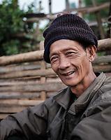 KYAING TONG, MYANMAR - CIRCA DECEMBER 2017: Portrait burmese man smiling and looking at camer at the Pin Tauk village<br /> Lahu tribe in Kyaing Tong.