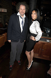 """MIKE FIGGIS and pianist ROSEY CHAN at a party and exclusive private view of 'Naked Portrait With Reflection"""" by Lucian Freud hosted by Christie's held at 17 Berkeley Street, London on 17th June 2008.<br /><br />NON EXCLUSIVE - WORLD RIGHTS"""