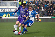 Callum Lang of Shrewsbury Town is tackled by Alfie Kilgour of Bristol Rovers during the EFL Sky Bet League 1 match between Bristol Rovers and Shrewsbury Town at the Memorial Stadium, Bristol, England on 29 February 2020.