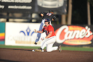 Mississippi's Sikes Orvis (24) doubles against Louisiana-Lafayette's jace Conrad (19) in an NCAA Super Regional game in Lafayette, La. on Saturday, June 7, 2014.    Louisiana-Lafayette won 9-5.