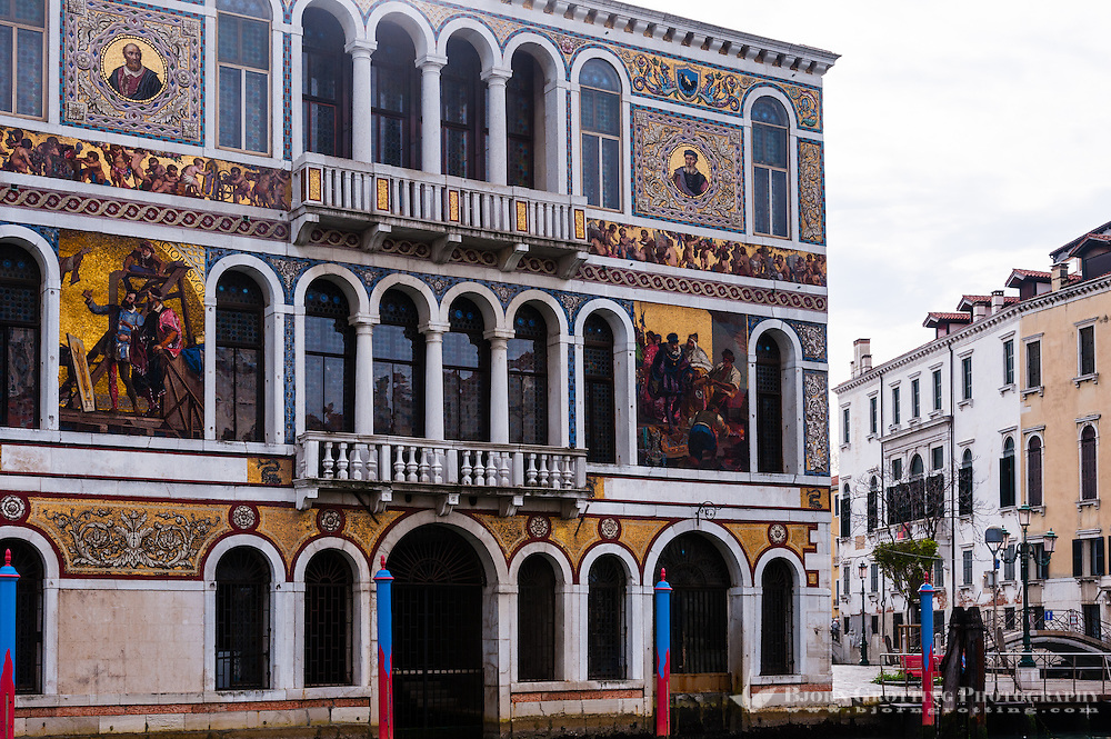 Italy, Venice. An old colourful building on Canal Grande.
