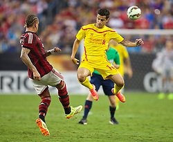 CHARLOTTE, USA - Saturday, August 2, 2014: Liverpool's Philippe Coutinho Correia in action against AC Milan during the International Champions Cup Group B match at the Bank of America Stadium on day thirteen of the club's USA Tour. (Pic by David Rawcliffe/Propaganda)