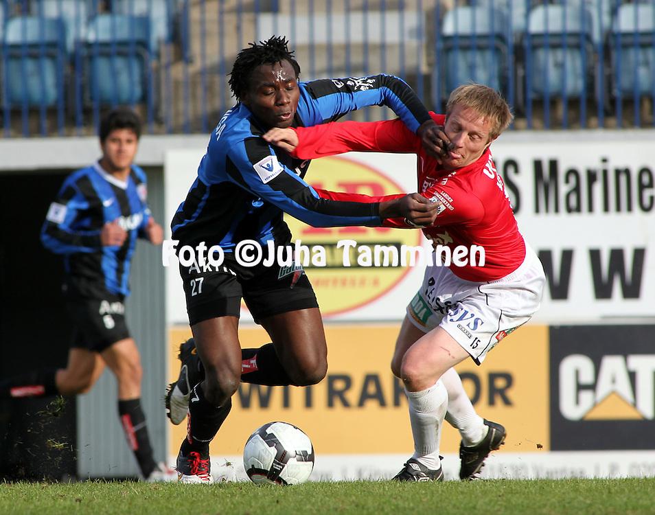 03.05.2010, Kupittaa, Turku..Veikkausliiga 2010, FC Inter Turku - FC Lahti..Kennedy Ugoala Nwanganga (Inter) v Jukka Vanninen (FC Lahti).©Juha Tamminen.