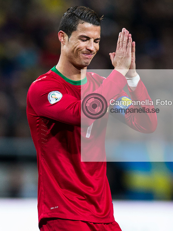 Solna 2013-11-19:  <br /> <br /> Portugal 7 Cristiano Ronaldo gestures with his hands in protest of a referring decision during Portugal's World Cup playoff match with Sweden. <br /> <br /> (Photo: Michael Campanella / Pic-Agency)