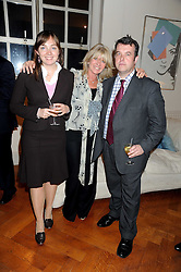 Left to right,    , INGRID SEWARD and DAVID POGSON at the launch party of Ingrid Seward's new book 'William & Harry - The People's Princes' held at 47 Hornton Court West, London W8 on 7th October 2008.