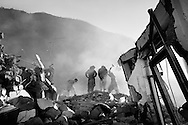 Men digging in the ruins of Balakot.<br /> Balakot  Dec. 2005-