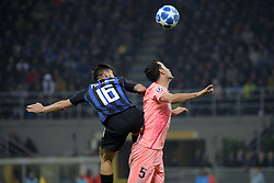 November 6, 2018 - Milan, Milan, Italy - Matteo Politano #16 of FC Internazionale Milano competes for the ball with Sergio Busquets #5 of FC Barcelona during  the UEFA Champions League group B match between FC Internazionale and FC Barcelona at Stadio Giuseppe Meazza on November 06, 2018 in Milan, Italy. (Credit Image: © Giuseppe Cottini/NurPhoto via ZUMA Press)