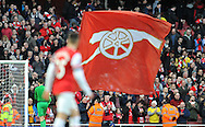 an Arsenal flag flying after full time during Barclays Premier League , Arsenal v Sunderland at the Emirates Stadium in London, England on Saturday 22nd Feb 2014.<br /> pic by John Fletcher, Andrew Orchard sports photography.