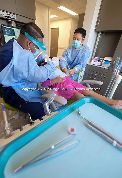 Davis Hong, (R), DDS, of White Memorial Community Health Center. (Photo by Ringo Chiu)<br /> <br /> Usage Notes: This content is intended for editorial use only. For other uses, additional clearances may be required.
