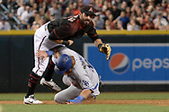 Apr 22, 2017; Phoenix, AZ, USA; Arizona Diamondbacks second baseman Daniel Descalso (3) turns the double play over Los Angeles Dodgers third baseman Justin Turner (10) during the third inning at Chase Field. Mandatory Credit: Jennifer Stewart-USA TODAY Sports