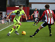 Huddersfield Town defender Tommy Smith taking on Brentford midfielder John Swift during the Sky Bet Championship match between Brentford and Huddersfield Town at Griffin Park, London, England on 19 December 2015. Photo by Matthew Redman.