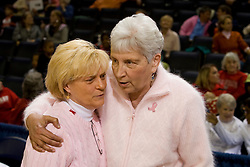 "Cancer survivors NC State head coach Kay Yow and Virginia head coach Debbie Ryan share a hug before the start of a basketball game.  The game was part of the Women's Basketball Coachs Association's ""Think Pink initiative to raise awareness of education cancer prevention.  The Virginia Cavaliers faced NC State Wolfpack women's basketball team at the John Paul Jones Arena in Charlottesville, VA on February 1, 2008."