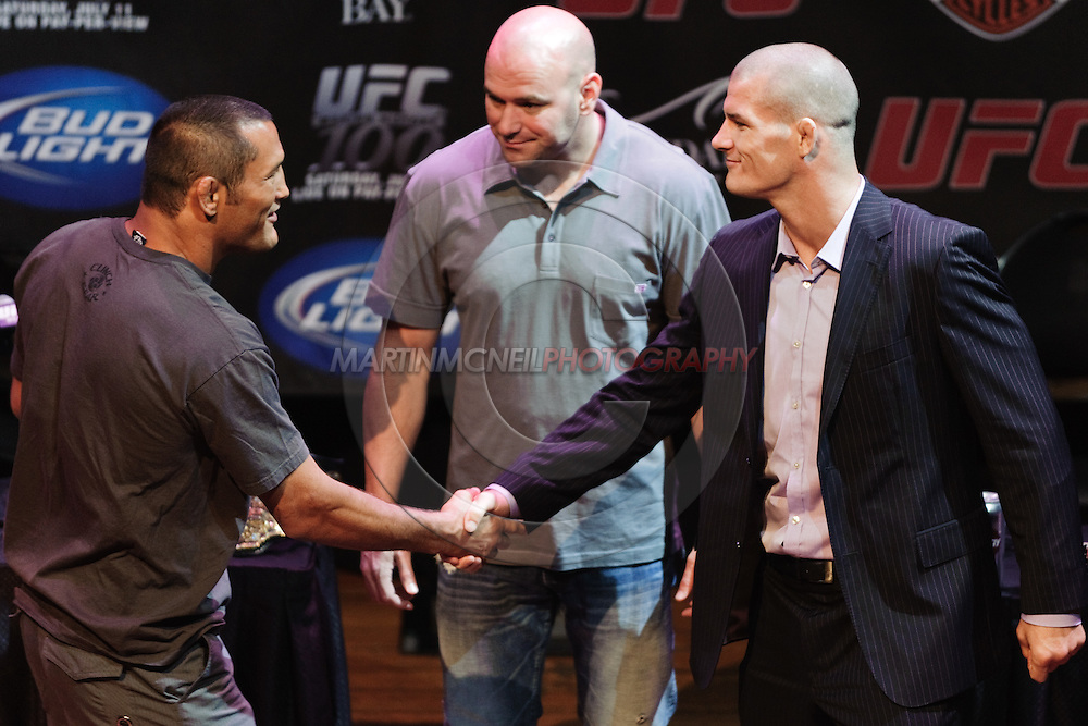 LAS VEGAS, NEVADA, JULY 9, 2009: Dan Henderson (left) shakes hands with opponent Michael Bisping during the pre-fight press conference for UFC 100 inside the House of Blues in Las Vegas, Nevada