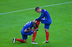 PARIS, FRANCE - Sunday, July 3, 2016: France's Antoine Griezmann celebrates scoring the fourth goal against Iceland with team-mate Dimitri Payet kissing his left boot during the UEFA Euro 2016 Championship Semi-Final match at the Stade de France. (Pic by Paul Greenwood/Propaganda)