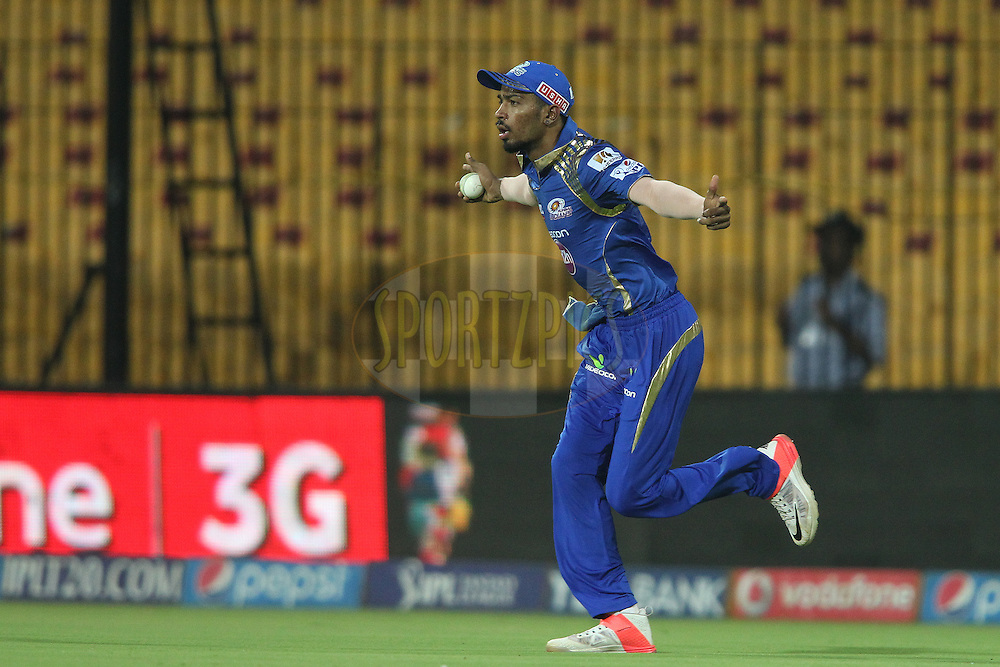 Hardik Pandya of Mumbai Indians celebrates taking the catch to get Brendon McCullum of Chennai Super Kings wicket during match 43 of the Pepsi IPL 2015 (Indian Premier League) between The Chennai Super Kings and The Mumbai Indians held at the M. A. Chidambaram Stadium, Chennai Stadium in Chennai, India on the 8th May April 2015.<br /> <br /> Photo by:  Shaun Roy / SPORTZPICS / IPL