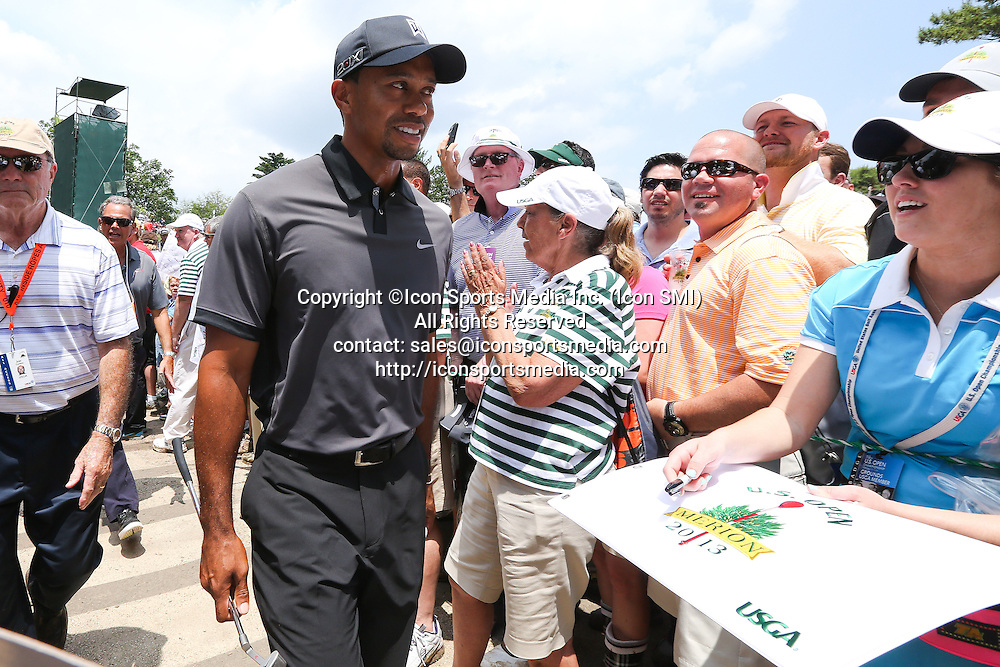 June 11 2013: Tiger Woods smiles at fans while walking from between holes during tuesday's practice round at the 2013 U.S. Open hosted by Merion Golf Club in Ardmore, PA.