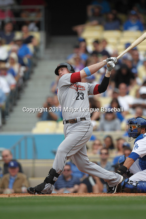 LOS ANGELES - JUNE 19:  Chris Johnson #23 of the Houston Astros takes a swing at a pitch during the game against the Los Angeles Dodgers at Dodger Stadium on Sunday, June 19, 2011 in Los Angeles, California.  The Dodgers defeated the Astros 1-0.  (Photo by Paul Spinelli/MLB Photos via Getty Images) *** Local Caption *** Chris Johnson