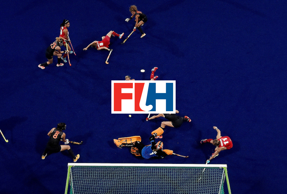 Britain's Alex Danson (C) dives to score a goal during the women's Gold medal hockey Netherlands vs Britain match of the Rio 2016 Olympics Games at the Olympic Hockey Centre in Rio de Janeiro on August 19, 2016. / AFP / MANAN VATSYAYANA        (Photo credit should read MANAN VATSYAYANA/AFP/Getty Images)