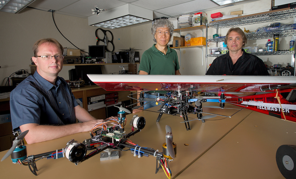 Russ College of Engineering faculty (Left to Right) Maarten Uijt De Haag, Jim Zhu and Tony Adami collaborate on work related to unmaned aerial vehicles. Photo by Ben Siegel/ Ohio University