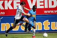 Fotball , 04. juli 2009 , Tippeligaen , Eliteserien ,  Sandefjord - Odd 1-2<br /> <br /> Morten Fevang , Odd og Malick Mane , Sandefjord