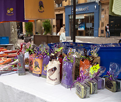 Provencal designed towels and scented soaps are hot sellers as souvenirs at the public market on the Cours Mirabeau, Aix-en-Provence, France.