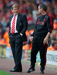 LIVERPOOL, ENGLAND - Saturday, April 23, 2011: Liverpool's manager Kenny Dalglish MBE and assistant manager Steve Clarke during the Premiership match against Birmingham City at Anfield. (Photo by David Rawcliffe/Propaganda)