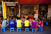 Crowd sit along a local beef noodle restaurant near Dong Xuan Market, Hanoi, Vietnam, Southeast Asia