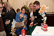 LISA ARMSTRONG; STEPHEN JOHNSON, Smythson Royal Wedding exhibition preview. Smythson together with Janice Blackburn has commisioned 5 artist designers to create their own interpretations of  Royal wedding memorabilia. Smythson. New Bond St. London. 5 April 2011.  -DO NOT ARCHIVE-© Copyright Photograph by Dafydd Jones. 248 Clapham Rd. London SW9 0PZ. Tel 0207 820 0771. www.dafjones.com.