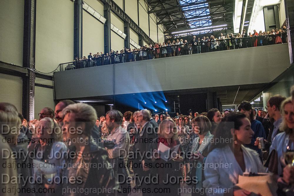 GALLERYGOERS LISTENING TO FRANCES MORRIS OPENING SPEECH, New Tate Modern opening party, Bankside. London. 16 June 2016