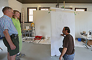 Tom Torluemke (right) works on a sketch of Dennis Beatty and Jackie Soukup of Cedar Rapids at the Firehouse Studio next to CSPS Hall, 1103 Third St SE in Cedar Rapids on Saturday afternoon, June 2, 2012. In the background is the canvas that Torluemke will use for the final painting. (Stephen Mally/Freelance)